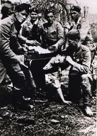 Ustaše_sawing_off_the_head_of_a_Serb_civilian